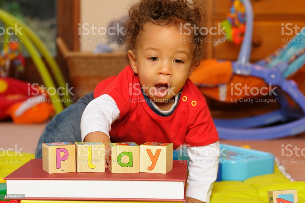 An enthusiastic baby playing stock photo