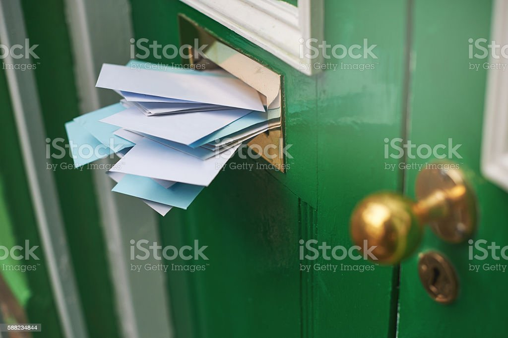 An entranceway filled with envelopes stock photo