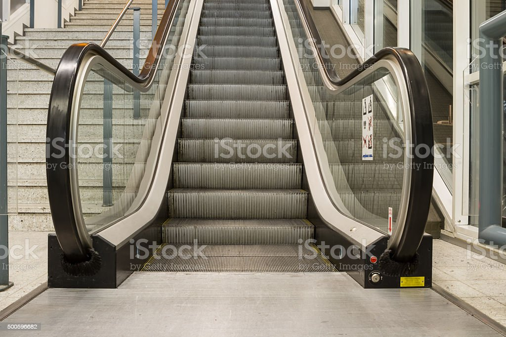 an escalator in the building stock photo