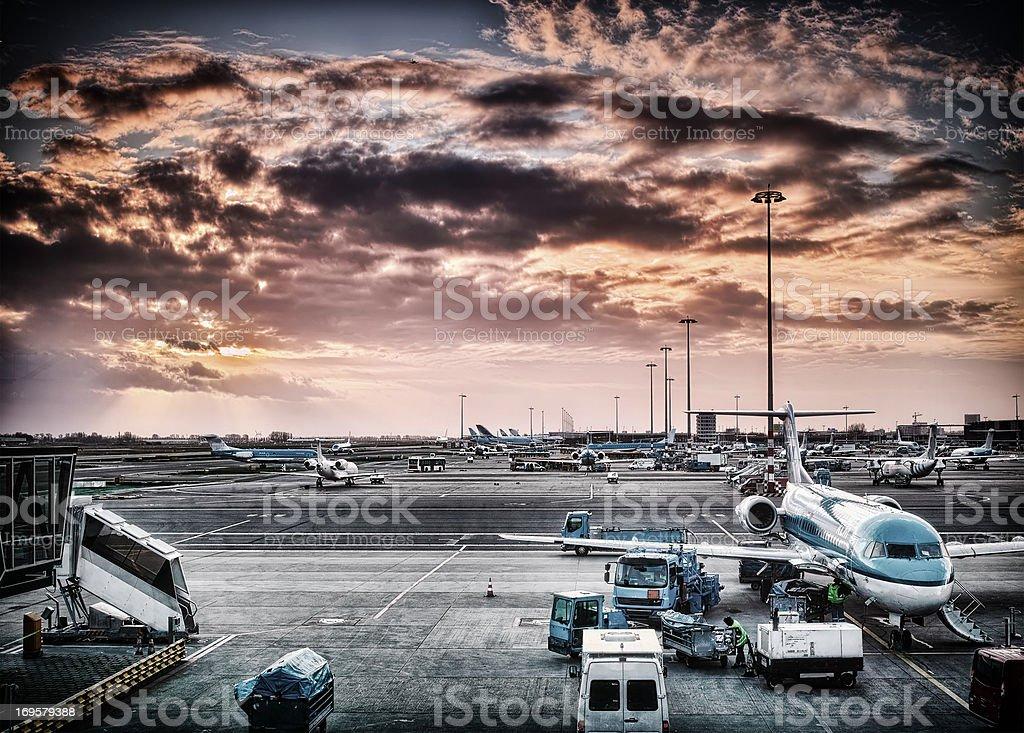 An evening photo of an airport stock photo