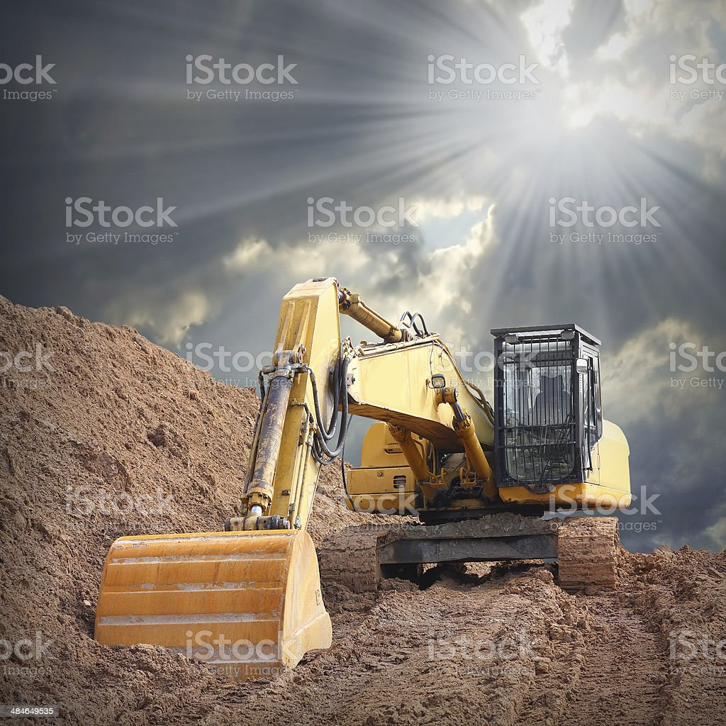 An excavator in old mine. stock photo