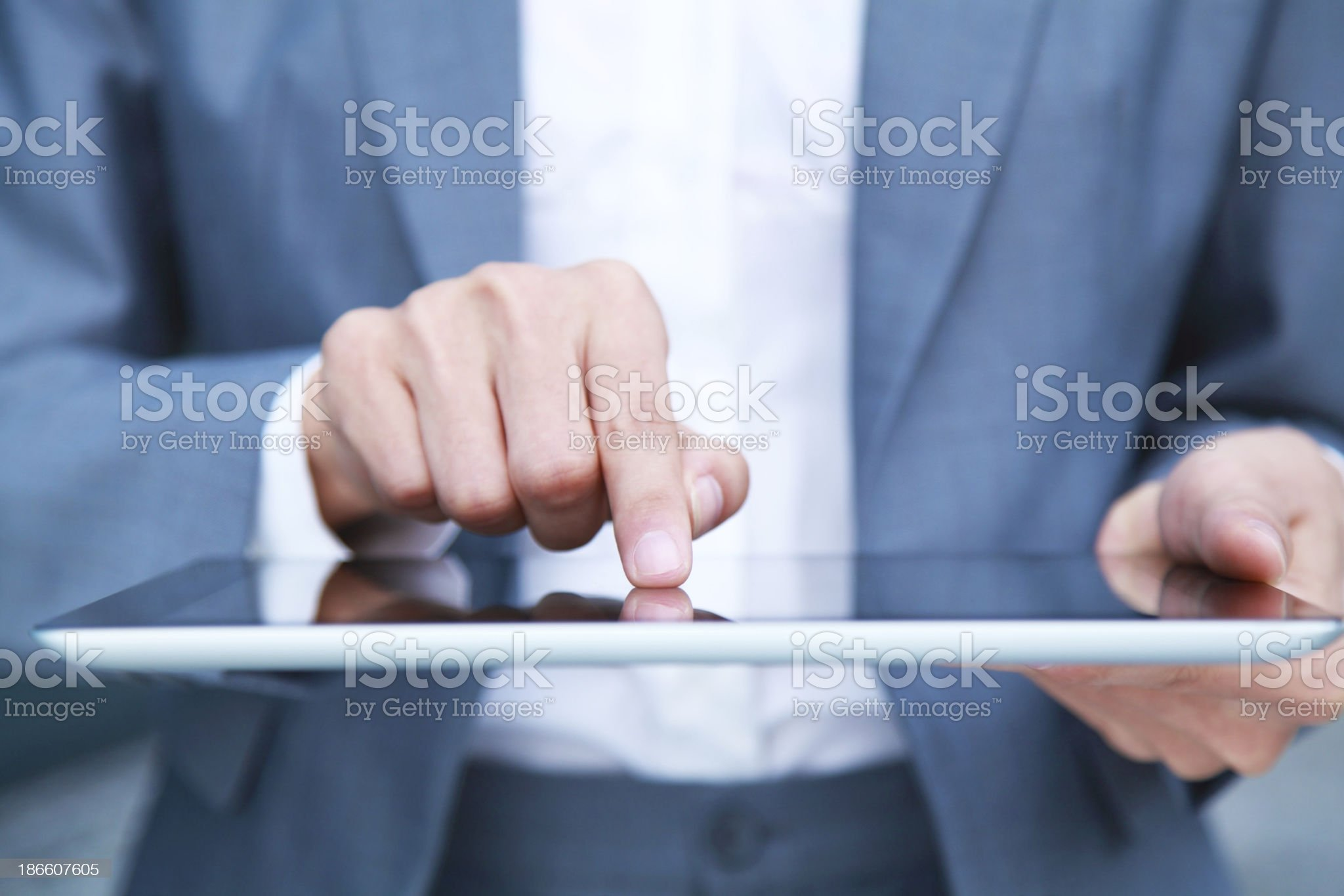 An executive hand shown using a digital tablet royalty-free stock photo