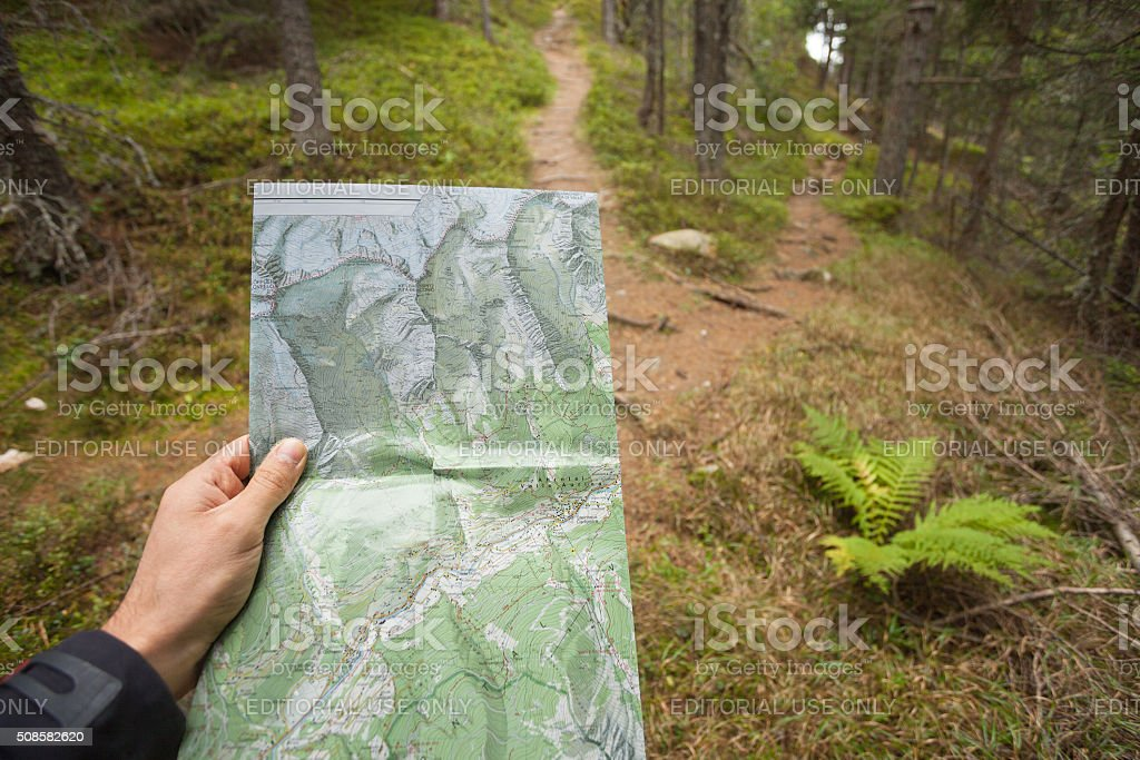 An hiker is finding the right position stock photo