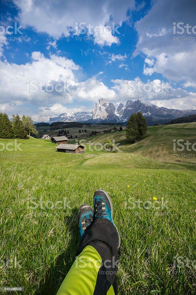 An hiker rests Alpe di Siusi/Seiser Alm stock photo