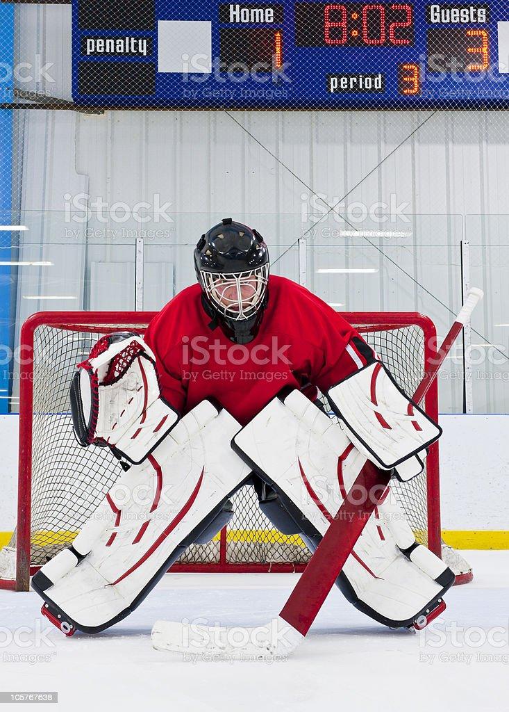 An ice hockey goalie defending his team's goal  stock photo