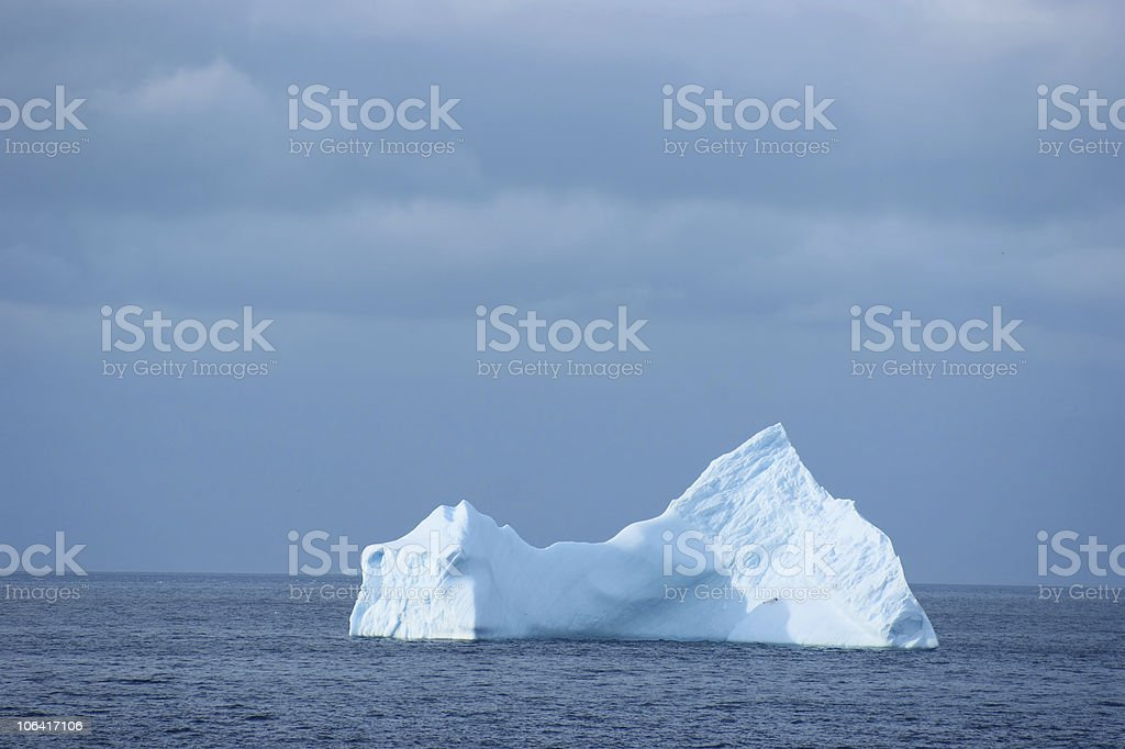 An iceberg in an ocean in the Antarctic royalty-free stock photo