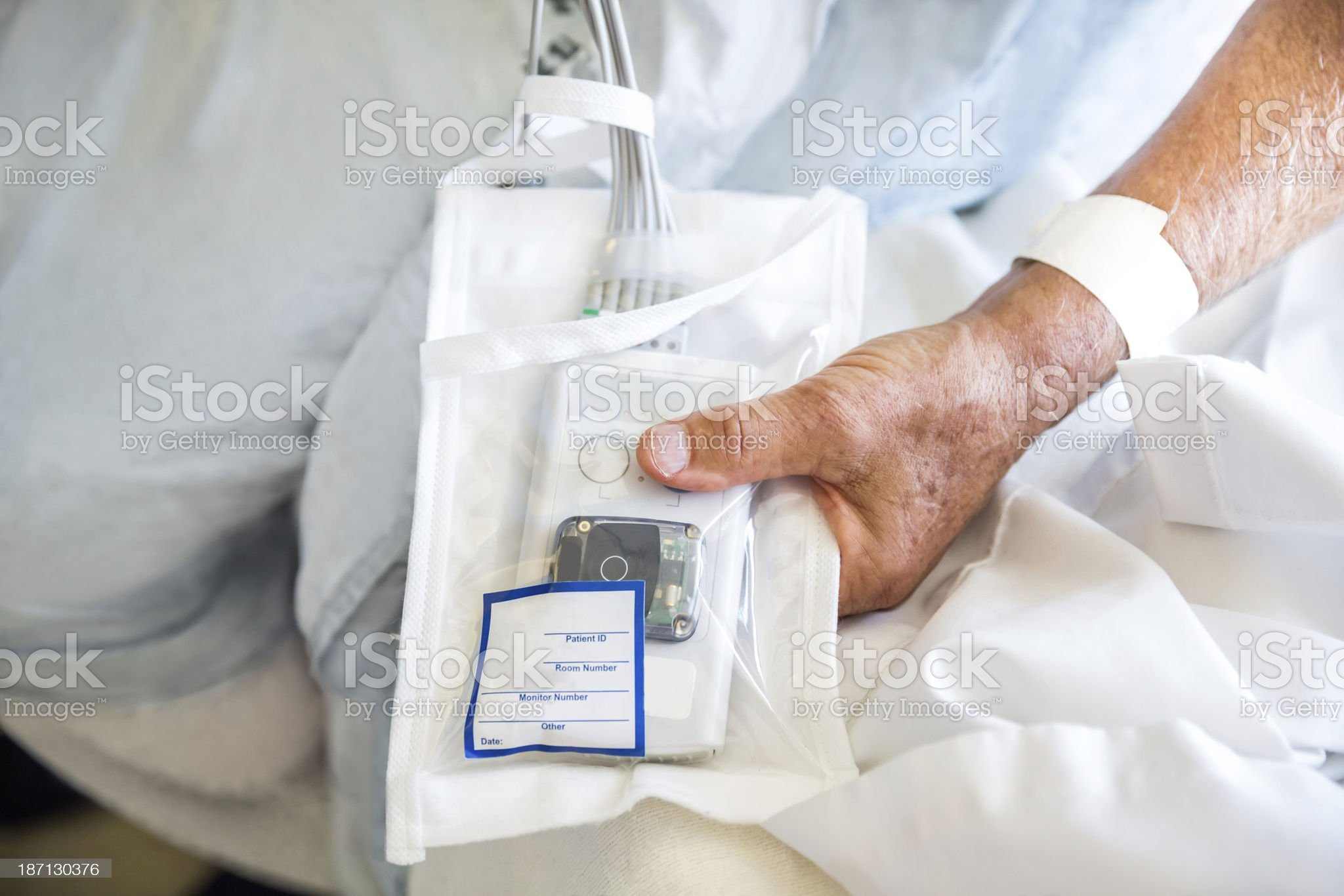 An ill male hospital patient holds teat monitor royalty-free stock photo