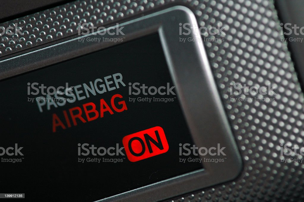 An illuminated display showing an airbag on stock photo