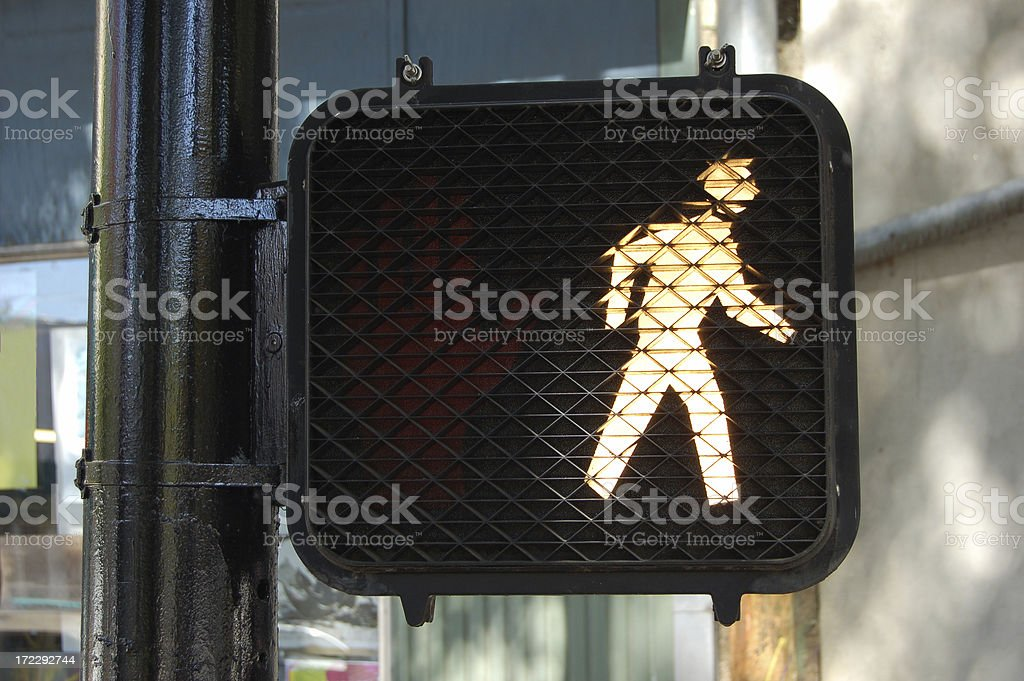 An illuminated walk street sign stock photo