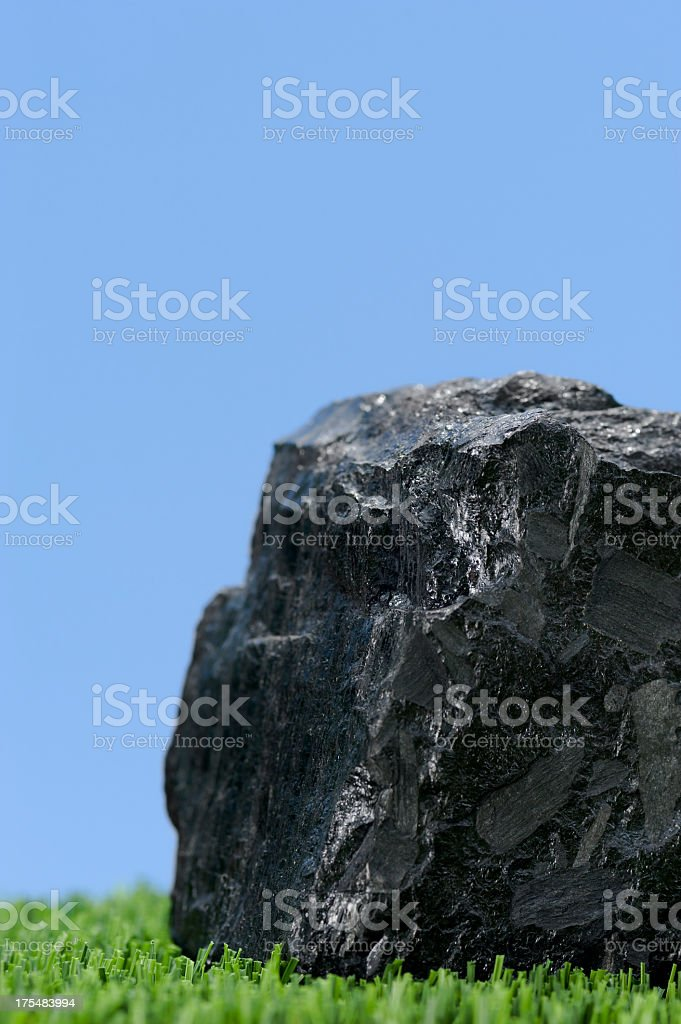 An image of a clean coal against the blue sky stock photo