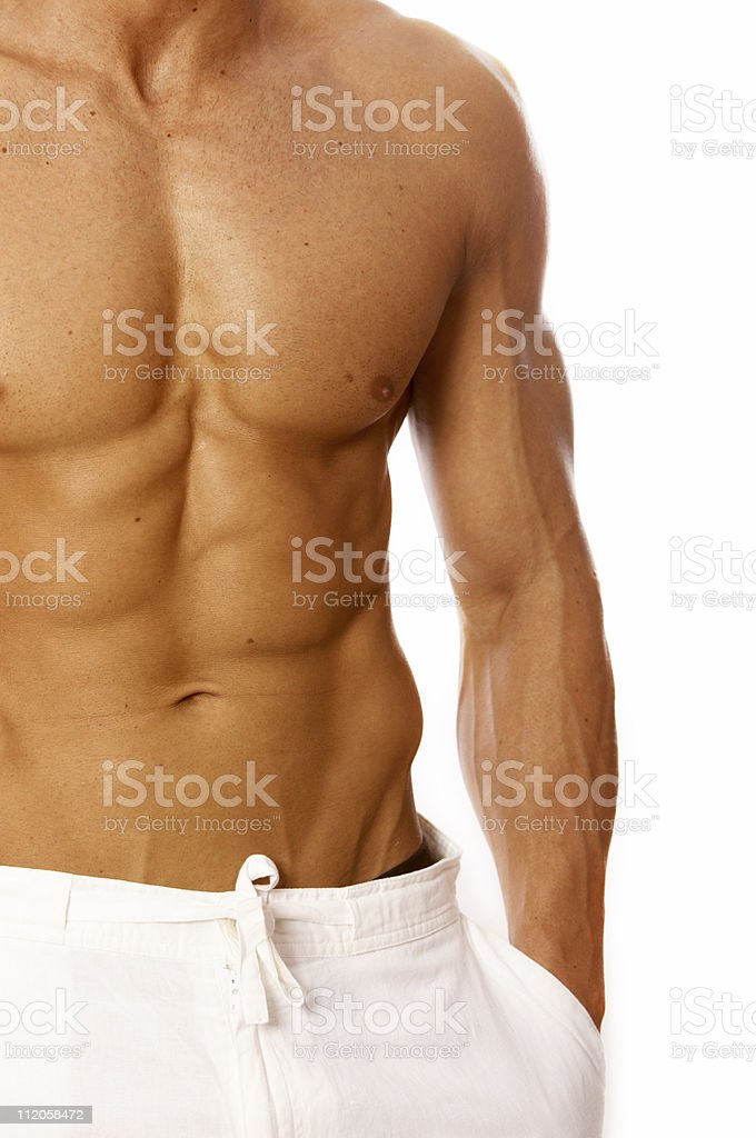An image of a man with well shaped abs royalty-free stock photo