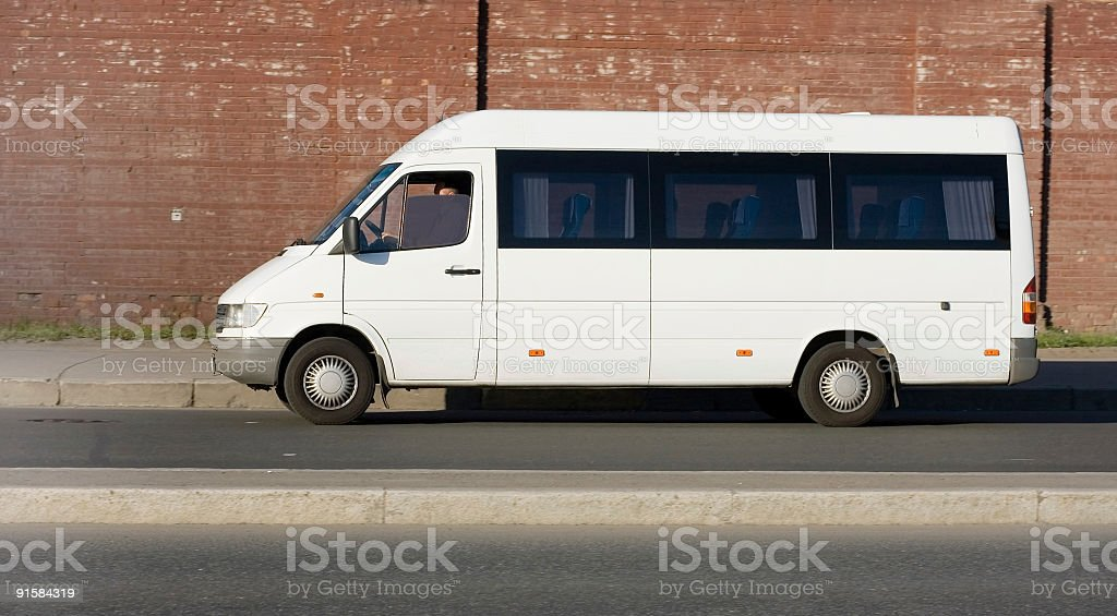 An image of a parallel parked shuttle bus stock photo