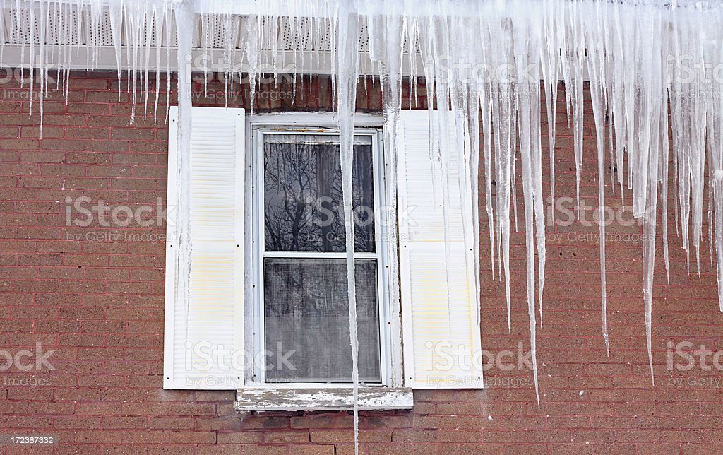 An image of a window with a frozen ice royalty-free stock photo