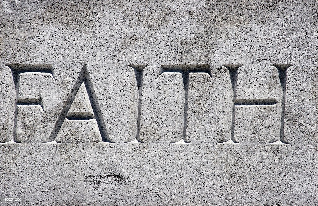 An image of faith etched in gray stone royalty-free stock photo