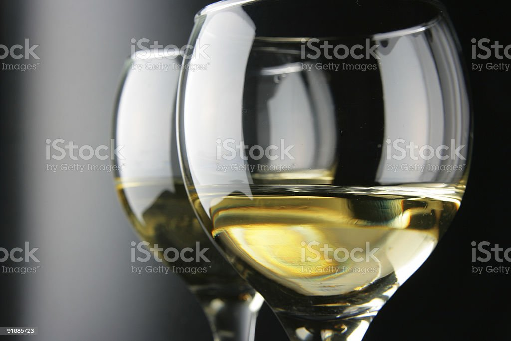An image of half a glass of wine and its reflection stock photo