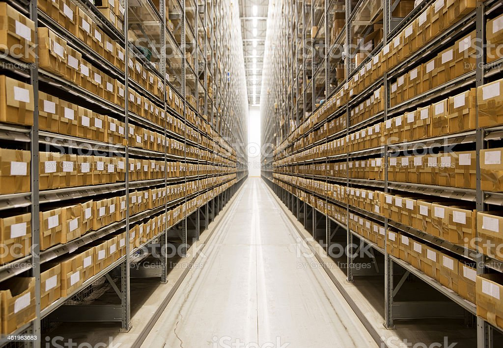 An image of long endless warehouse isle stock photo