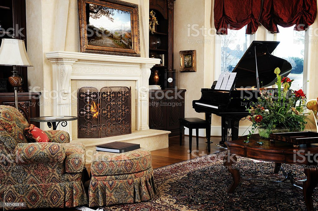 An image of the interior of a luxury home with fireplace stock photo