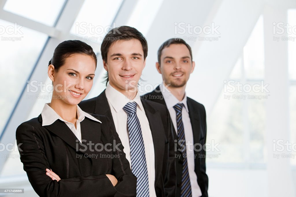 An image of three smiling business people stock photo