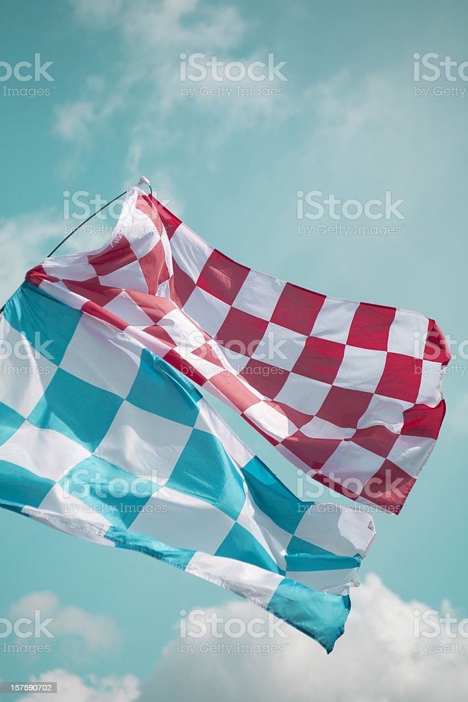 An image of two checkered flags shot from below royalty-free stock photo