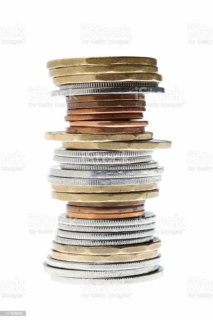 an imbalanced stack of Canadian coins stock photo