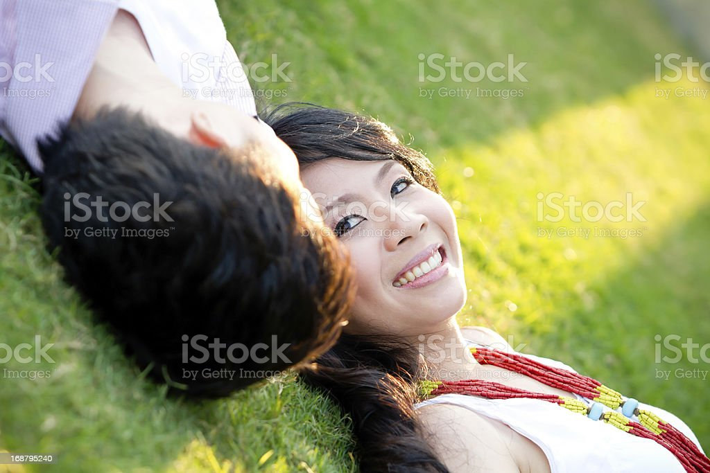 An in love young couple is relaxing near each others royalty-free stock photo