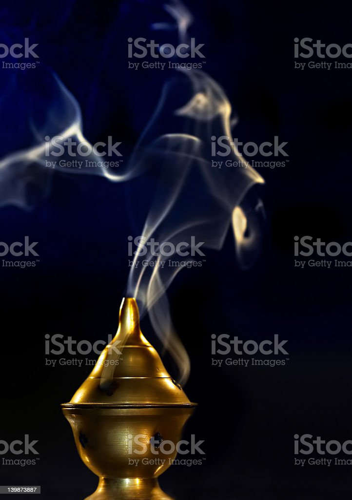 An incense being burned with beautiful smoke royalty-free stock photo