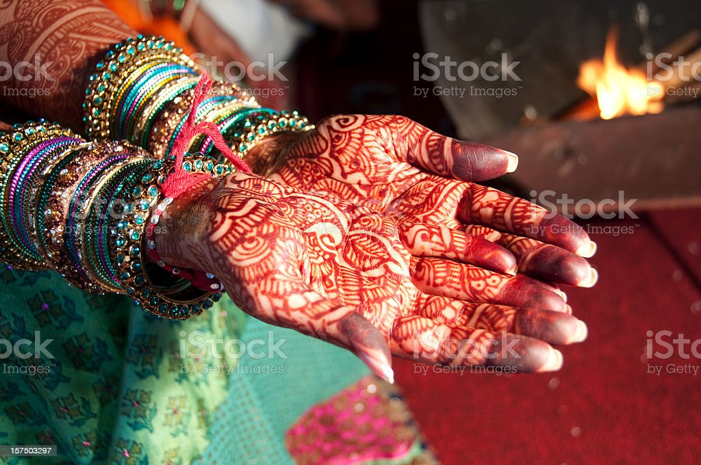 An Indian bride with hands full of henna stock photo