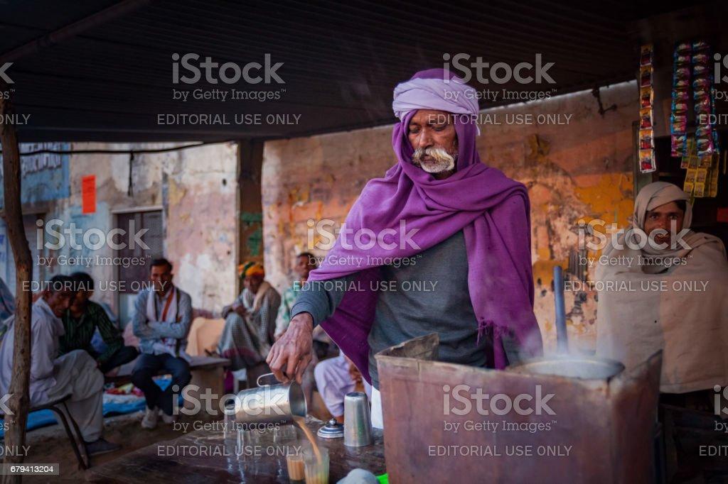 An Indian Rajasthani man at his tea stall at Chaksu fair in Jaipur stock photo
