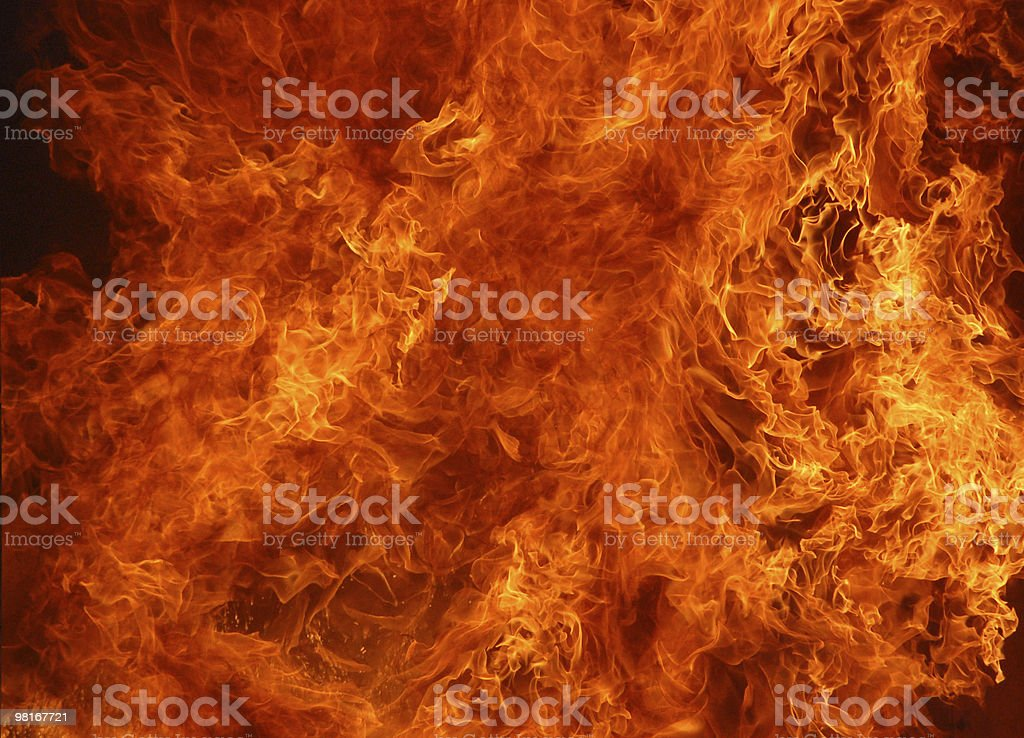 An inferno of red and orange flames stock photo