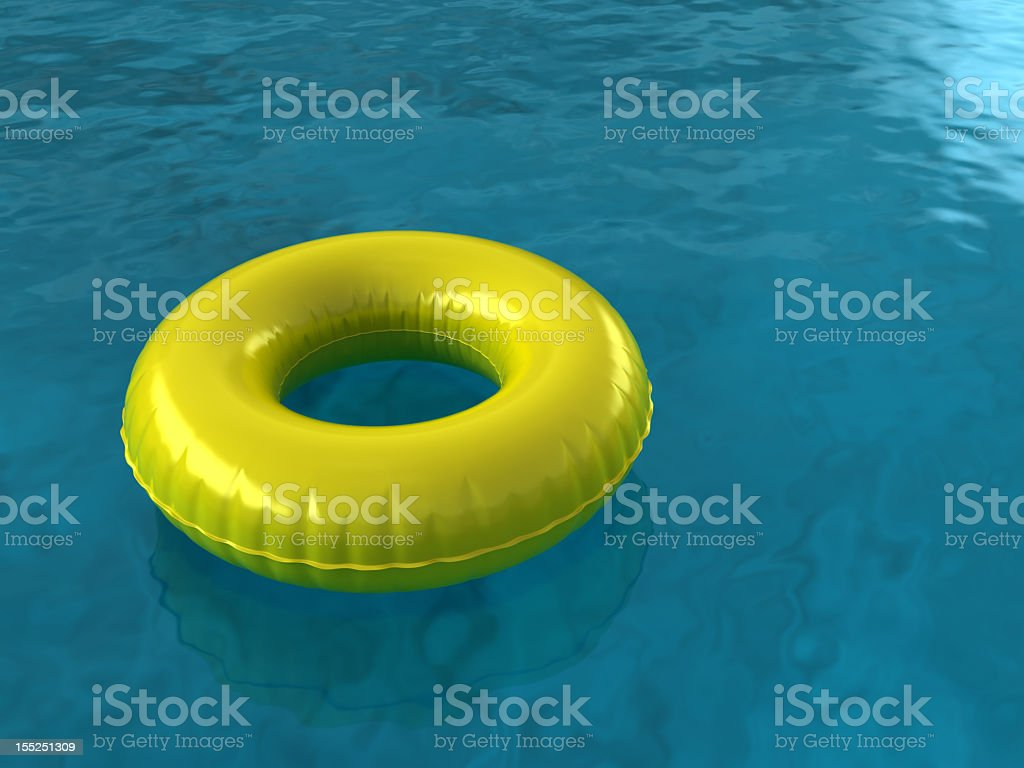 An innertube floating in blue waters stock photo