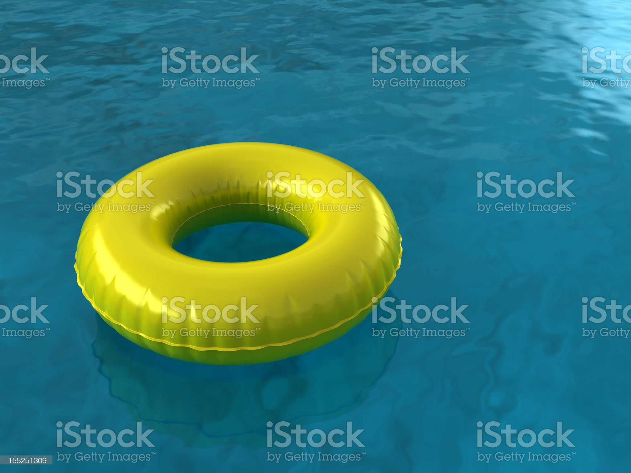 An innertube floating in blue waters royalty-free stock photo