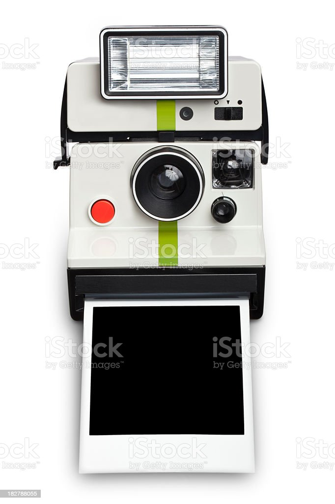 An instant camera with a flash developing film stock photo