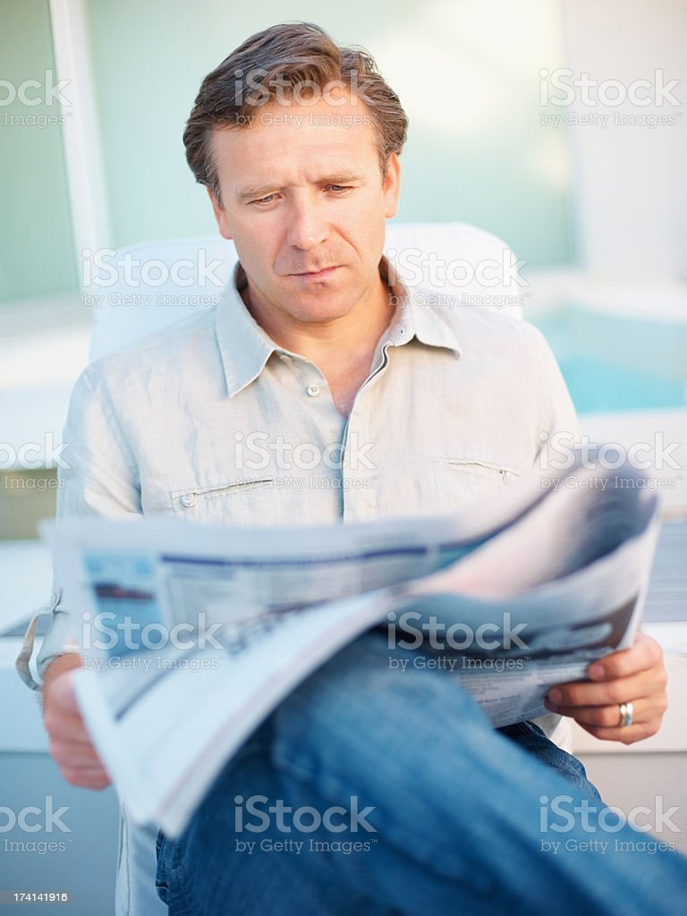 An interested and educated newspaper reader stock photo