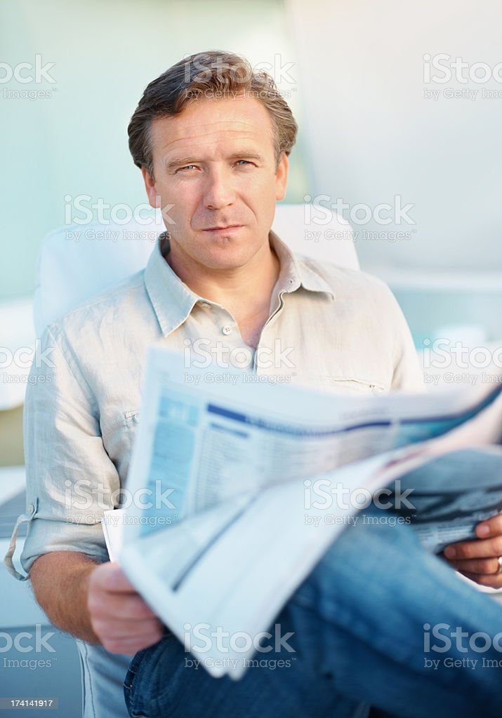 An interlectual and critical newspaper reader...Just like you stock photo