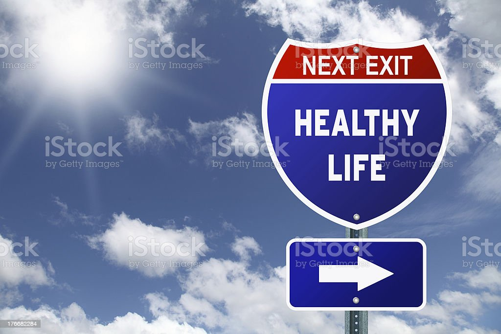 An interstate road sign pointing to healthy life stock photo