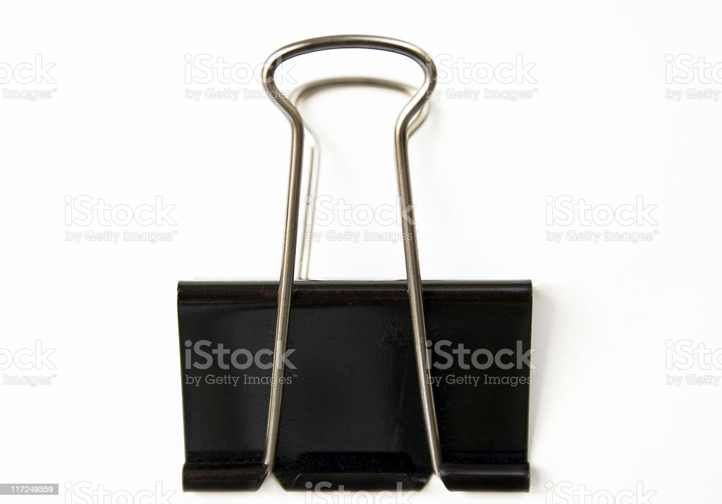 An isolated black clamp on a white background stock photo