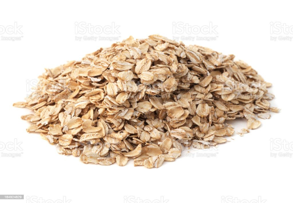 An isolated heap of healthy oatmeal stock photo