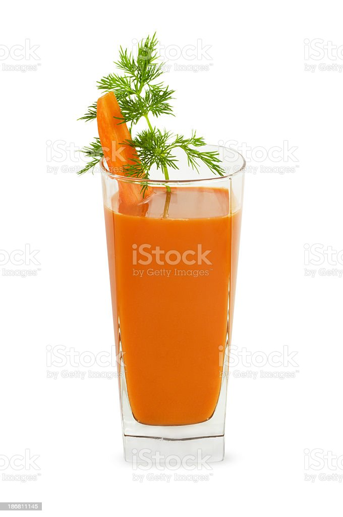 An isolated image of a glass of carrot juice stock photo