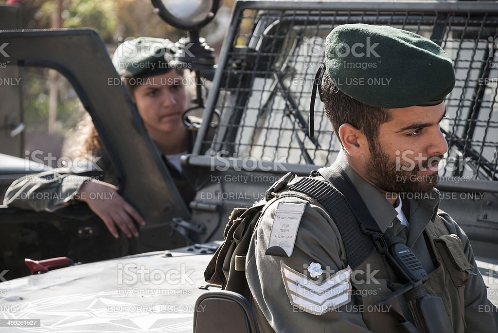 Male and female Israeli Border Police in East Jerusalem royalty-free stock photo