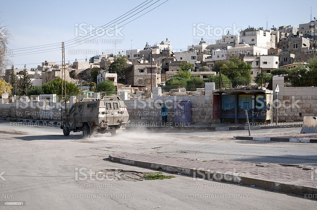 Israeli military vehicle on Shuhada Street in Hebron royalty-free stock photo