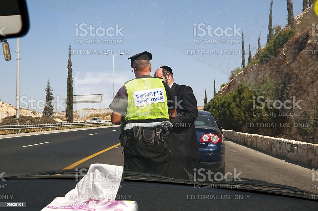 Getting a speeding ticket in Israel royalty-free stock photo