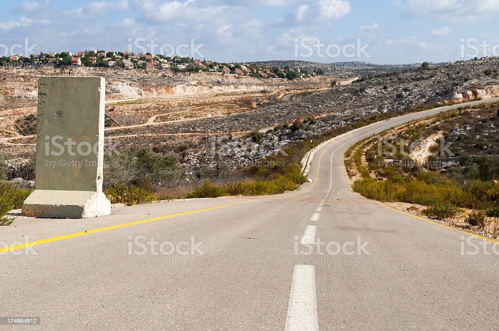 Israeli security road between Palestinian village and Israeli settlement royalty-free stock photo