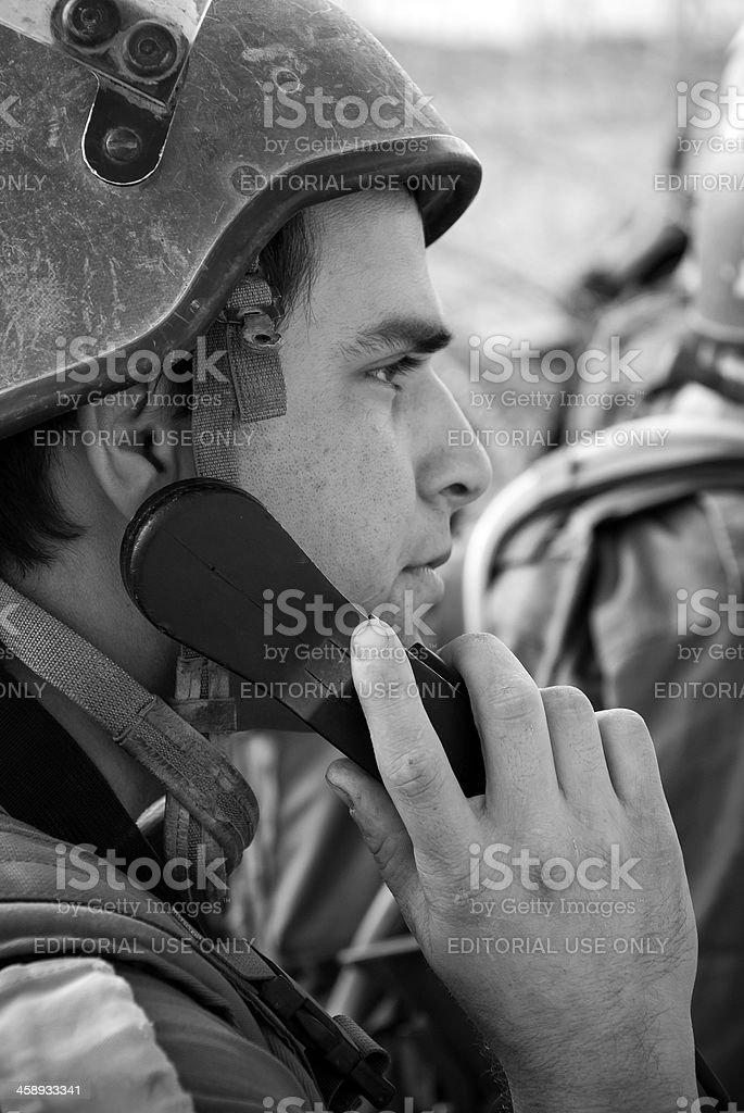 IDF soldier communicating in the field stock photo