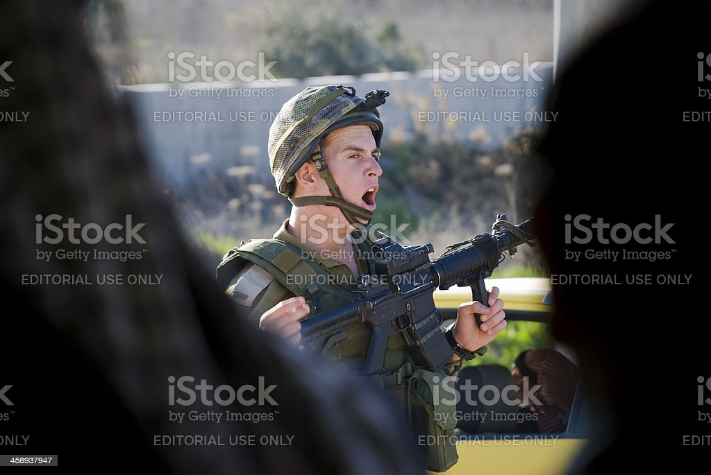 Yawning Israeli soldier at West Bank checkpoint royalty-free stock photo