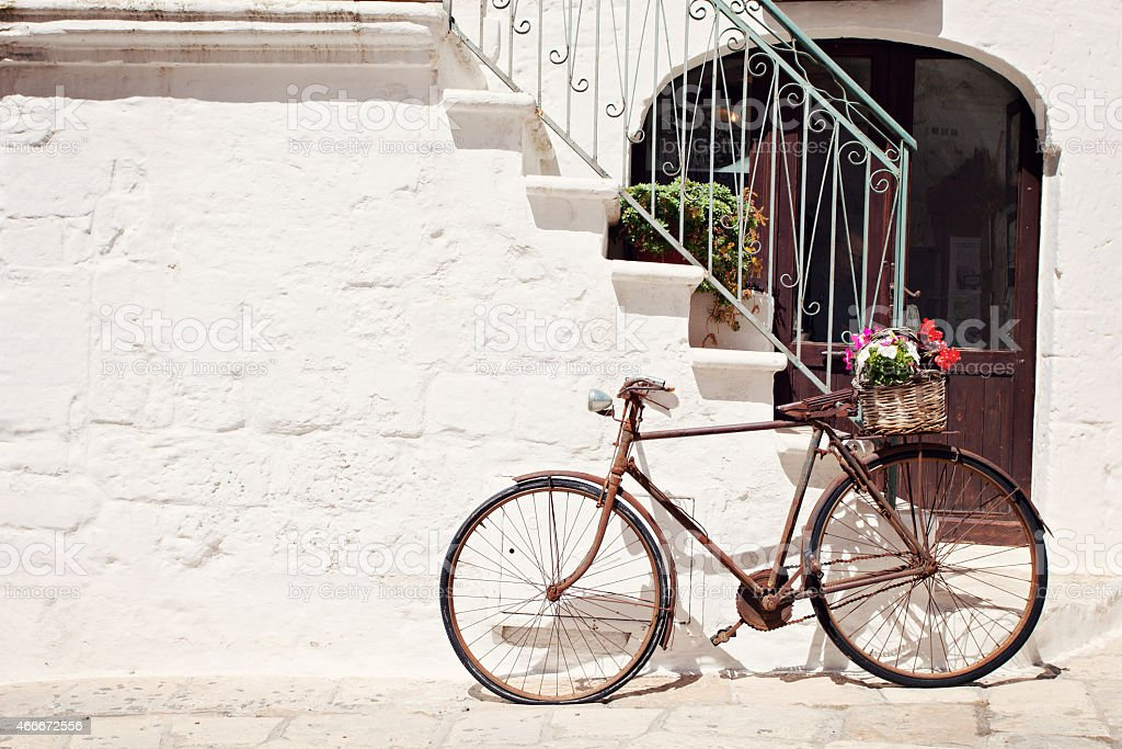 An Italian old style bicycle by the steps stock photo