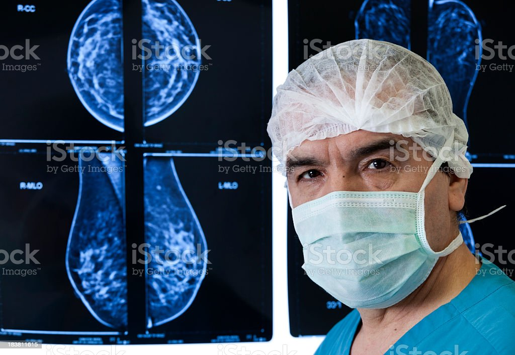 An MRI scan being reviewed by a doctor stock photo