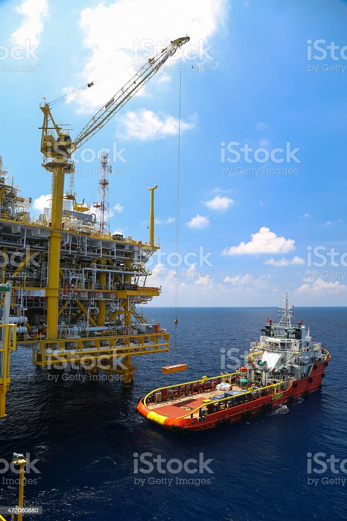 An ocean oil rig and a tanker  stock photo