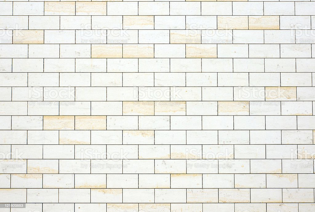 An off white and yellowish brick wall background stock photo