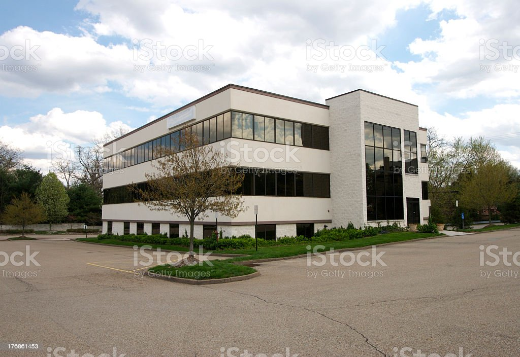 An office building with an empty parking lots stock photo