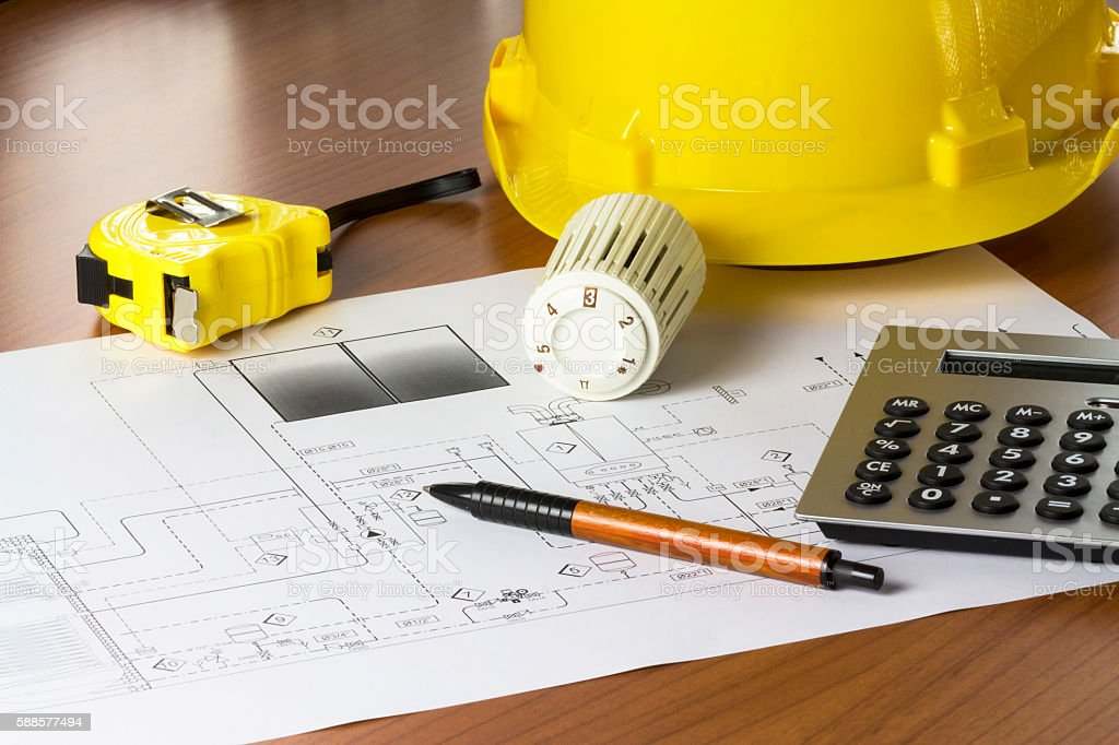 An office desk with thermostatic valve and hydraulic project stock photo